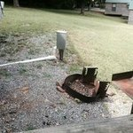 electrical box. fire pit, and grill - all on a steep slope