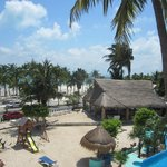 View of hotel palapa and beach across the street.