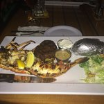 Surf and Turf. Half of my 3.5lb lobster, FIlet Mignon, Salad and a potato.