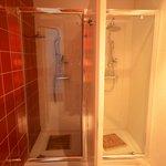 Bathroom shower stalls in 6-bed mixed dorm