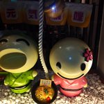 Cutesy mascots outside Japanese food outlet
