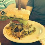 Burger with fried egg, jalapeno cheese bun, onions, lettuce, etc.