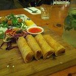 Delicious spring rolls, calamari and a mojito