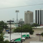 Front of room; Downtown Dallas in the distance