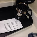 Has coffee pot but you must bring own coffee or pay  $2.00 at front desk for coffee