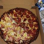Half pepperoni, half Hawaiian pizza