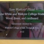 sign for the Sam Watkins' head statue in Children's section