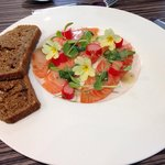 Cured Scottish salmon, Yorkshire rhubarb, pink peppercorns, foraged flowers, treacle bread