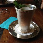 complimentary mint julep in a silver julep cup