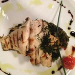 Grilled sea bass fillet marinated with thyme served with sauteed spinach