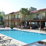 Pool and hotel with breakfast terrace