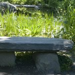 Big granite benches are thoughtfully placed along pathways