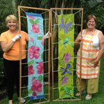 Students display their hand painted silk scarves