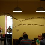 Quotations on wall, looking at entrance area.