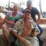 Enjoying the pool area and cold beverage with my wife and friend Dennis Pierce.