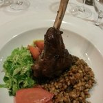 Lamb shank with tomato and pesto risotto