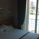 Bedroom with patio doors overlooking pool