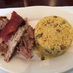 Lechon asado with arroz con gandules, tipical dish from Puerto Rico. Very tasty!!!!