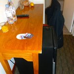 Bedroom desk and refrigerator