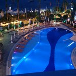 View of pool from room at night