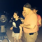 Family looking through the telescope