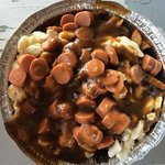 Poutine with hot dog added and peppercorn gravy.  Delicious!