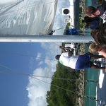 Crewmembers adjusting the sail