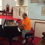my husband, Tracy Fansler playing the piano.