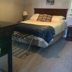 very comfortable Queen bed with 2 sided fireplace in updated luxury suite.