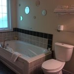 spacious bathroom with separate shower and jaccuzi tub  in luxury suite.