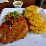 Pork chop plate with tostones and salad. So good!