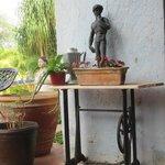 Many tasteful antiques on front deck.