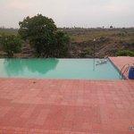 Infinity pool beside the hills.