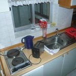 Poorly equipped kitchen. Note electric lead across hotplate due to lack of space.