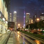 View from hotel entrance towards Oriental Pearl Tower, to left is the Ferrari dealer