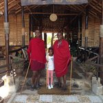 A photo of my daughter and the Masaai's at the entrance of Loyk Tsavo Camp