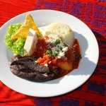 Delicious chile relleno with guacamole and refried beans, a traditional Guatemalan food.