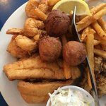 Three piece seafood combo plate (founder, shrimp, oysters) w/ fries and hush puppies