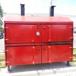 Huge red grill/smoker that faces Rt 9.