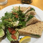 Salmon and cream cheese sandwich with salad