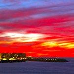 sunset seen at board walk breaking water