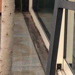 Rust on sliding doors at restaurant terrace
