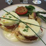 Eggs Benedict with tarragon bearnaise and back bacon, asparagus, grilled tomato and home fries