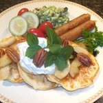 Cheddar pancakes with spiced apples, sausages and broccoli salad