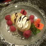 Poached pears with raspberries and chocolate drizzle