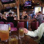 Tiki Bar is relaxed and open air, across from the beach