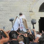 Ste. Sara, in effigy, emerges to parade down to the sea where she waited for the Maries.