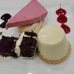 Trio of desserts - honey & lemon pannacotta, eton mess icecream and belgian chocolate gateau