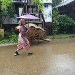 Street performer braving the downpour