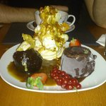 Dessert platter - meringue and puff candy ice cream, chocolate and kiwi bomb & sticky toffee pud